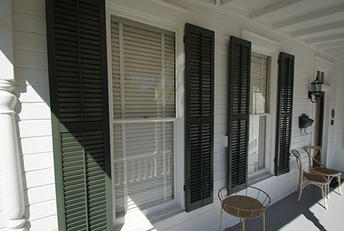 Green shutters on outside of house